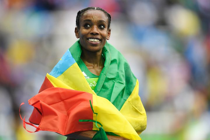 Almaz Ayana of Ethiopia reacts to winning the gold and setting the world record (29:17.45) in the women's 10,000-meter race.