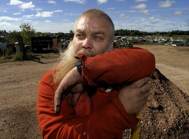 Steven Avery rests on the handle of a shovel after doing some work at the family salvage yard Thursday,...