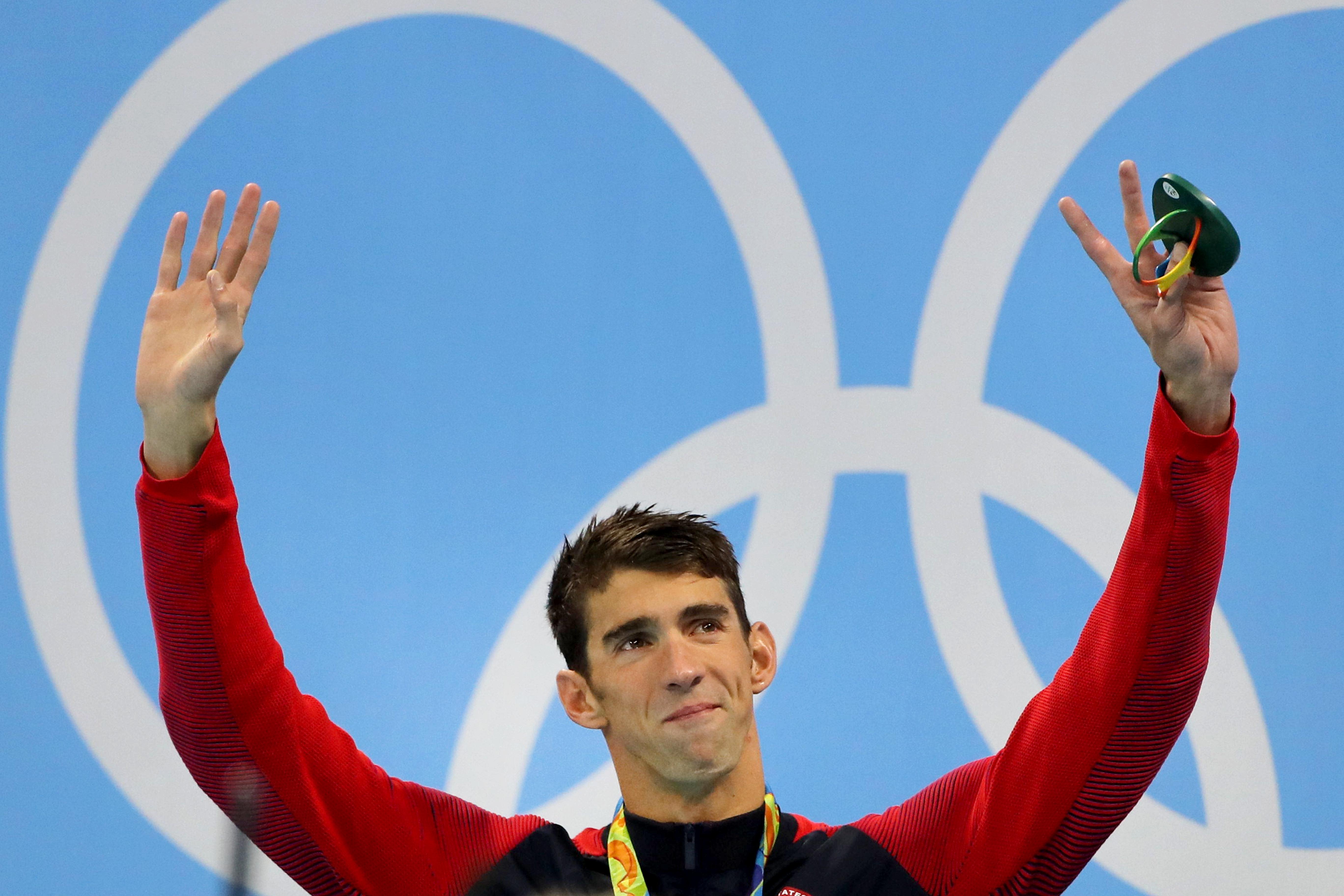 Michael Phelps waves fromthe podium at the Olympic aquatics stadium on Thursdayin Rio de...