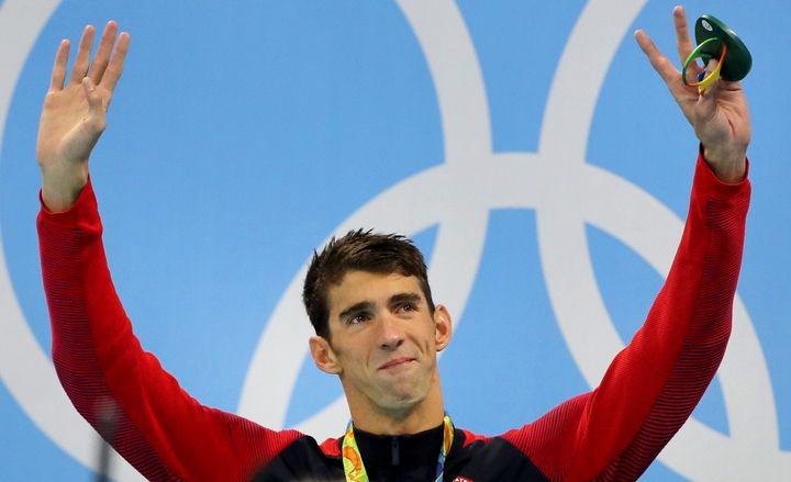 Michael Phelps waves from the podium at the Olympic aquatics stadium on Thursday in Rio de Janeiro, Brazil.