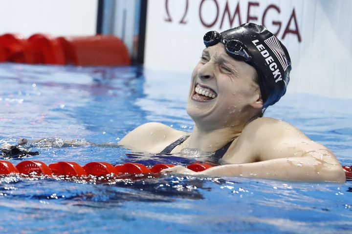 Katie Ledecky celebrates after she broke the world record to win the Women's 800m Freestyle Final during the swimming event a