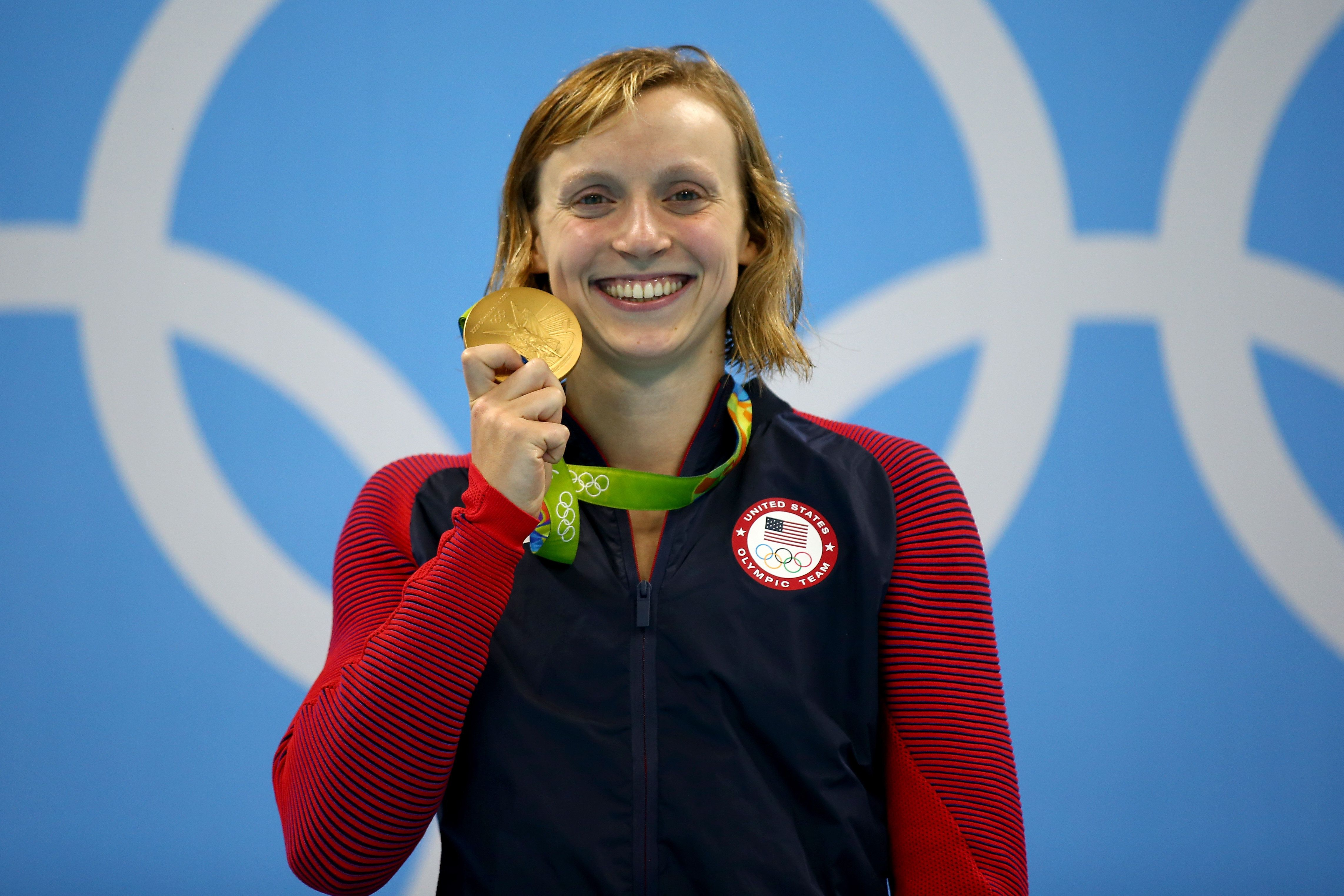 RIO DE JANEIRO, BRAZIL - AUGUST 12:  Katie Ledecky of United States celebrates on the podium after winning gold in the Women's 800m Freestyle Final on Day 7 of the Rio 2016 Olympic Games at the Olympic Aquatics Stadium on August 12, 2016 in Rio de Janeiro, Brazil.  (Photo by Clive Rose/Getty Images)