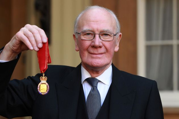 Sir Menzies Campbell holds his medal after being made a Companion of Honour by the Duke of