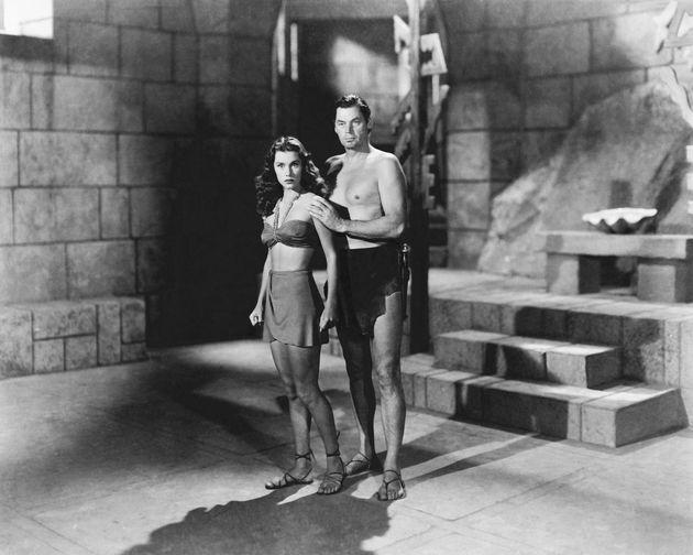 Johnny Weissmuller (1904 - 1984) as Tarzan, and Brenda Joyce (1917 - 2009) as Jane, in 'Tarzan And The