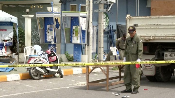 Police Explosive Ordnance Disposal (EOD) official inspects the site of a bomb blast in Hua Hin, south of Bangkok, Thailand, i