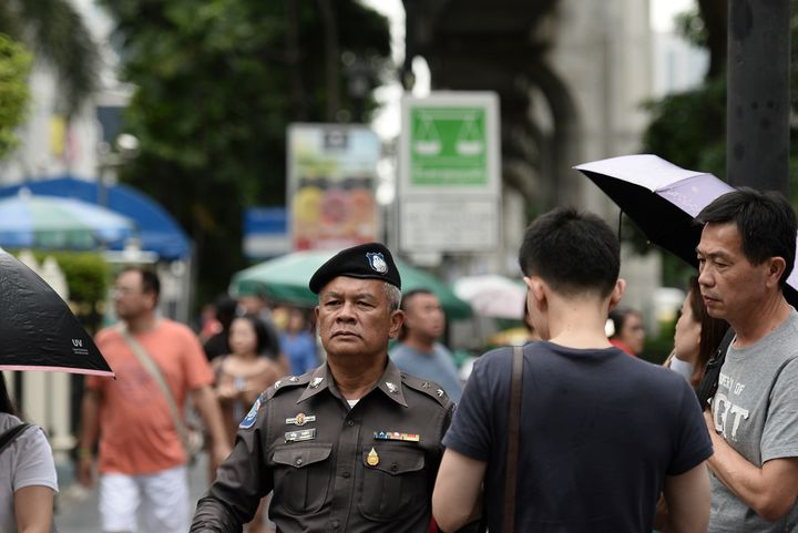 A Thai policeman patrols near the Erawan Shrine, the site of a bombing in August 2015 that left 20 dead and scores injured, i