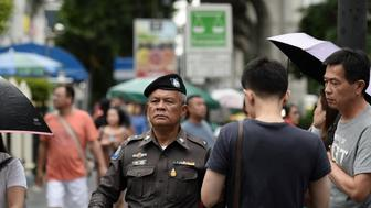 A Thai policeman patrols near the Erawan Shrine, the site of a bombing in August 2015 that left 20 dead and scores injured, in the centre of Bangkok on August 13, 2016 as authorities increase security following a new string of bomb attacks in Thailand. Thai authorities on August 13 hunted for culprits behind the wave of bombings targeting popular holiday destinations, as businesses braced for the economic fallout from the attacks on the crucial tourism industry. / AFP / MUNIR UZ ZAMAN        (Photo credit should read MUNIR UZ ZAMAN/AFP/Getty Images)