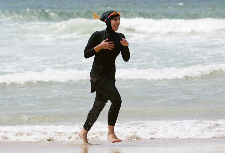 Mecca Laalaa, a volunteer with a surf lifesaving patrol in Sydney, runs on the beach in 2007.