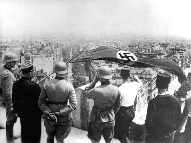 German occupation of Paris, World War II, June 1940. The Nazi flag flying from the Arc de