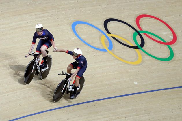 Katie Archibald of Great Britain, left, celebrates with teammate Laura Trott, right, after the women's...