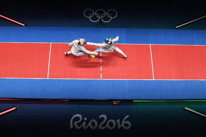 Ibtihaj Muhammad competes against Italy's Rossella Gregorio during the women's team sabre bronze medal bout between.