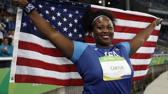 Gold medallist USA's Michelle Carter celebrates winning the Women's Shot Put Final during the athletics event at the Rio 2016 Olympic Games at the Olympic Stadium in Rio de Janeiro on August 12, 2016.   / AFP / Adrian DENNIS        (Photo credit should read ADRIAN DENNIS/AFP/Getty Images)