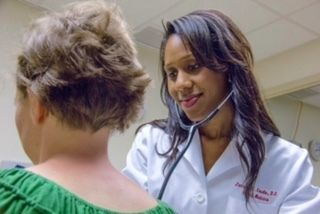 Dr. Caudle seeing a patient in her Sewell, NJ office.