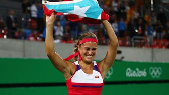 RIO DE JANEIRO, BRAZIL - AUGUST 13:  Monica Puig of Puerto Rico reacts after defeating Angelique Kerber of Germany in the Women's Singles Gold Medal Match on Day 8 of the Rio 2016 Olympic Games at the Olympic Tennis Centre on August 13, 2016 in Rio de Janeiro, Brazil. Puig defeated Kerber 6-4, 4-6, 6-1.  (Photo by Clive Brunskill/Getty Images)