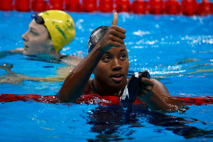Simone Manuel celebrates in the second Semifinal of the Women's 50m Freestyle on Day 7 of the Rio 2016 Olympic Games on Augus