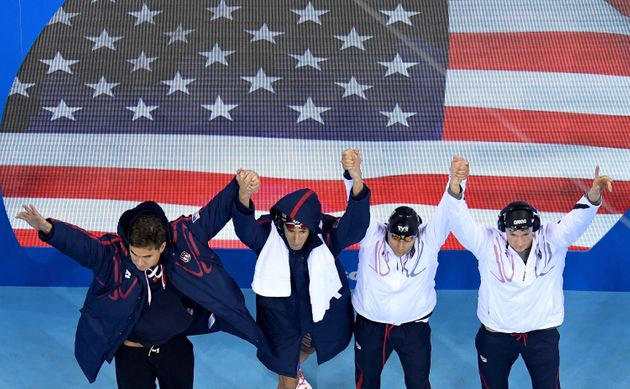 Nathan Adrian, Ryan Murphy, Michael Phelps and Cody Miller of the United States greetthe crowd...