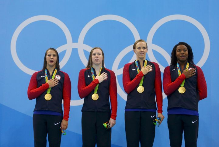Gold medallists Kathleen Baker (USA) of USA, Lilly King (USA) of USA, Dana Vollmer (USA) of USA and Simone Manuel (USA) of US