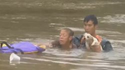 Harrowing Video Shows Baton Rouge Woman, Dog Pulled From Sinking
