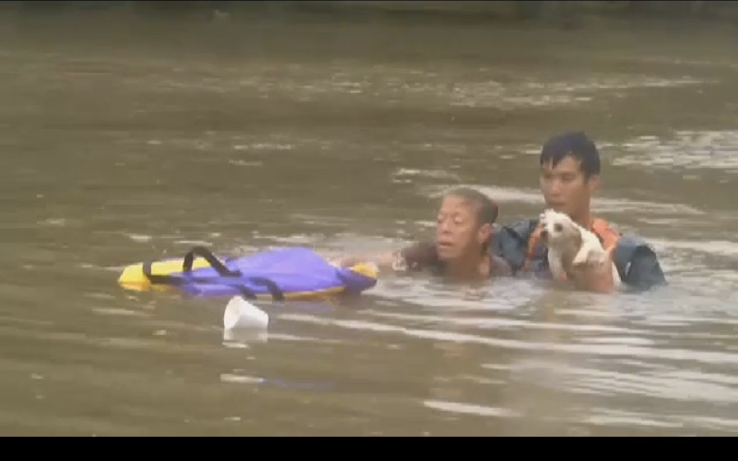 A woman and her dog are seen moments after they were pulled from a sinking car by this man in Baton Rouge.
