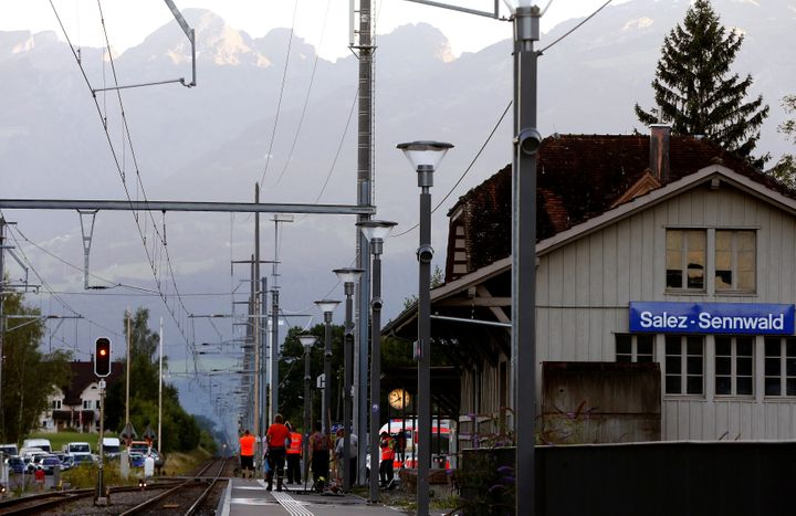 Workers clean a platform after a 27-year-old Swiss man's attack on a Swiss train at the railway station in the town of Salez,