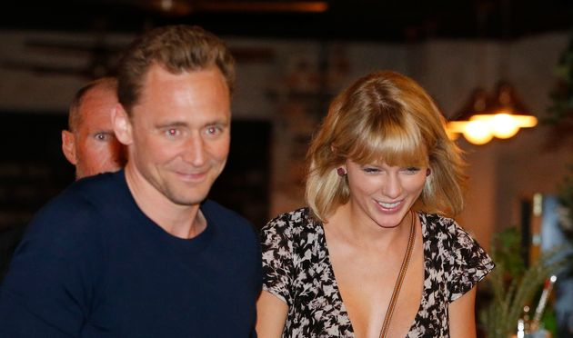 Actor Tom Hiddleston and singer Taylor Swift having a grand old time during Tom's