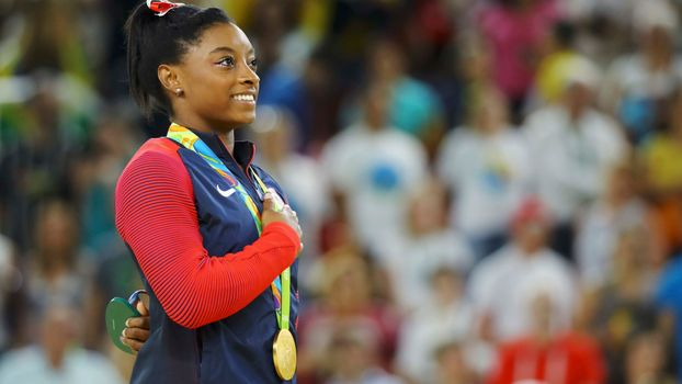 Simone wins third gold medal