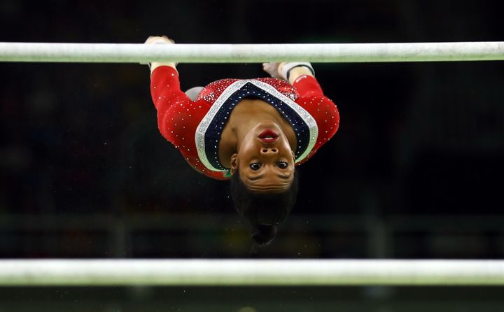 Gabby Douglas competes in the uneven bars final on August 14, 2016 in Rio de Janeiro.