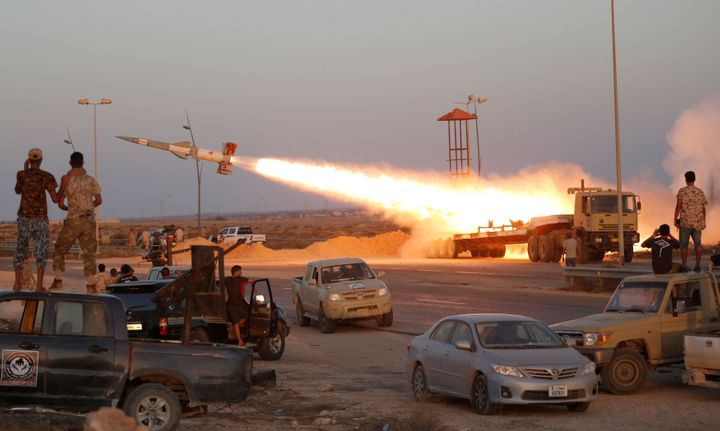 Fighters of Libyan forces allied with the U.N.-backed government fire a rocket at Islamic State fighters in Sirte, Libya, Aug