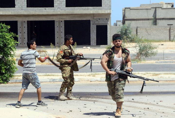 Forces loyal to Libya's UN-backed Government of National Accord (GNA), holding a position in al-Zaafaran neighbourhood, fire