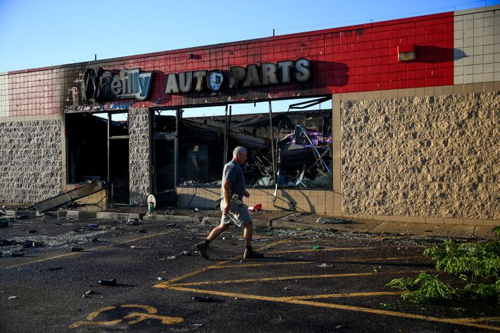 A man walks by an O'Reilly Auto Parts store that was destroyed during protests following apoliceshooting in Milwa
