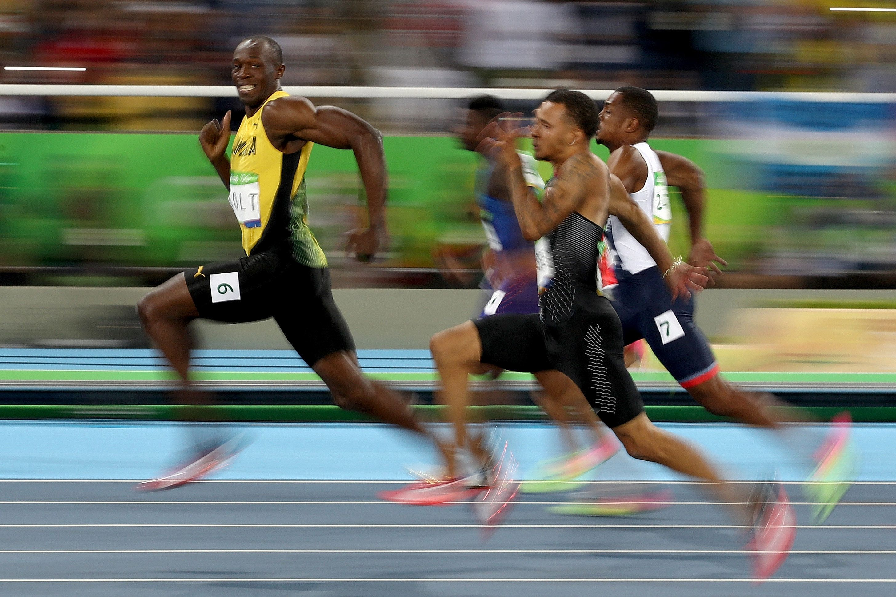 Bolt's meme-worthy grin during Sunday evening's 100-meter dash semi-finals. He cruised ahead of American Justin Gatlin and ot