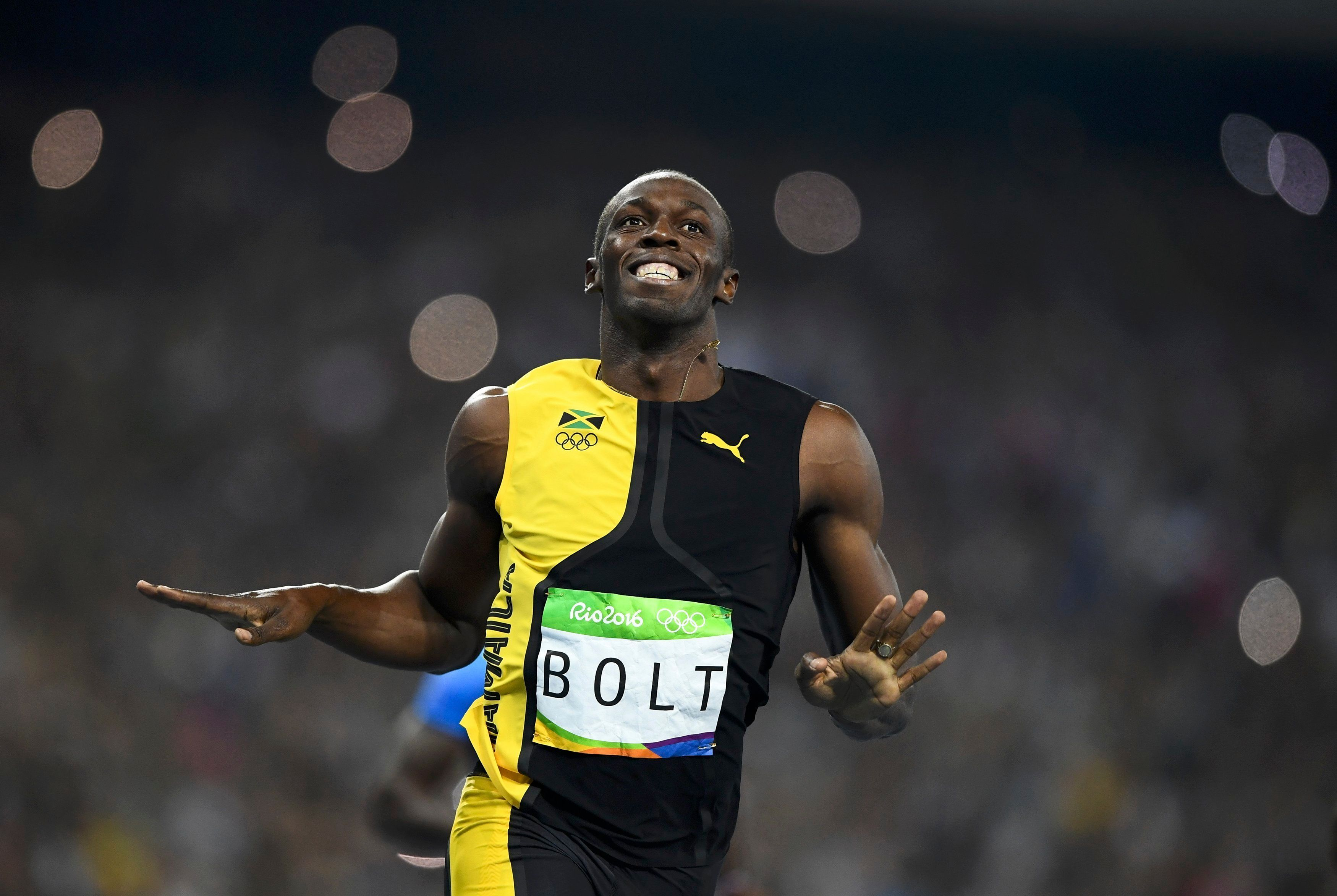 Jamaican Usain Bolt won the men's 100-meter dash for the third consecutive time.
