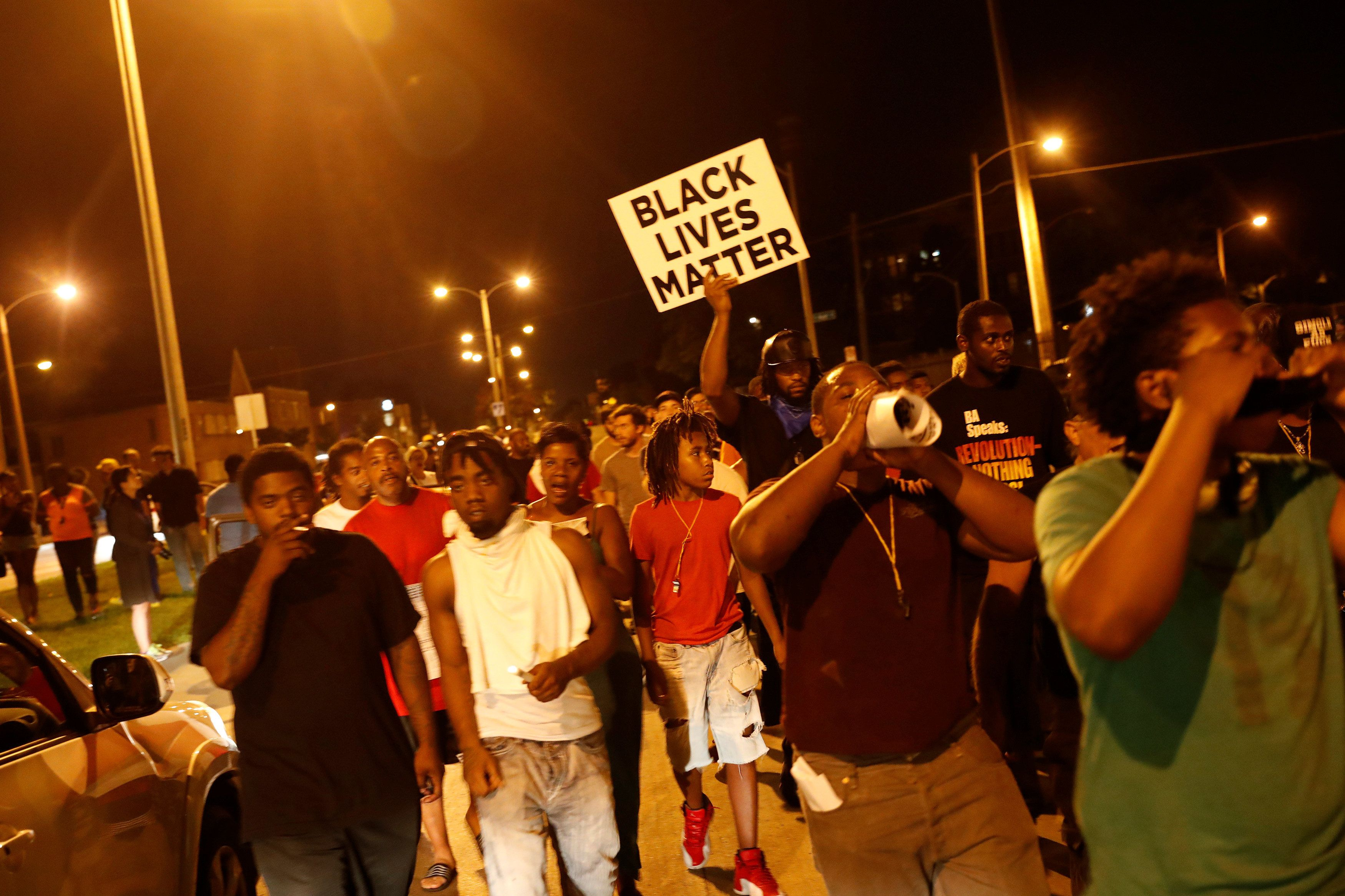 Protesters marched on Sunday following the police shooting of an armed manin Milwaukee.