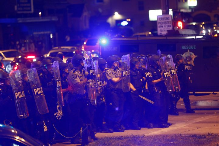 Seventeen people were arrested, and four officers were injured, after violence broke out during demonstrations on Saturday.