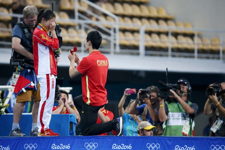 Chinese diver He Zi accepted boyfriend and teammate Qin Kai's proposal shortly after medal ceremony Sunday.