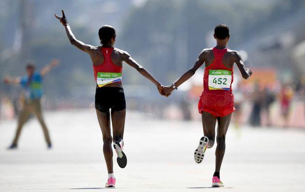 Kenya's Jemima Sumgong and Bahrain'sEunice Jepkirui Kirwacelebrate taking gold and silver...