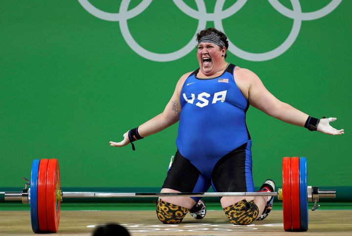 Robles, shown celebrating, had a combined lift total of 286 kilograms.