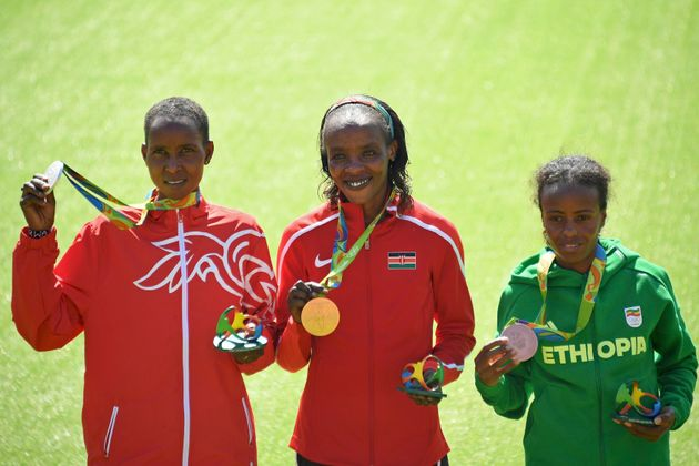 Kirwa (left) and Sumgong (center) were joined on the podium by Ethiopia's Mare Dibaba, who took bronze...