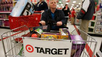 """A woman rides a motorized shopping cart through a Target store on the shopping day dubbed """"Black Friday"""" in Torrington, Connecticut November 25, 2011. The U.S. holiday shopping season was in full-swing on Thursday, with retailers hoping consumers will spend big despite worries about the fragile economy and their own precarious finances.To narrow the gap in store hours with rivals, discounter Target Corp electronics chain Best Buy and department store chains Macy's Inc and Kohl's Corp will open at midnight, their earliest starts ever. REUTERS/Jessica Rinaldi (UNITED STATES - Tags: BUSINESS)"""