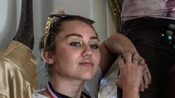 Liam Hemsworth And Miley Cyrus Go For Gold At Bizarre Themed