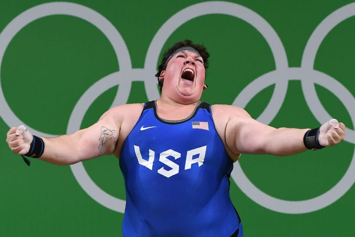 Sarah Elizabeth Robles reacts while competing during the Women's weightlifting +75kg event at the Rio 2016 Olympic Games on A