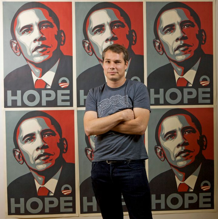 Shepard Fairey poses in front of his art in January 2009.