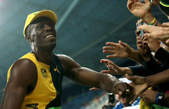 Usain Bolt celebrates another gold in the 100-meters.