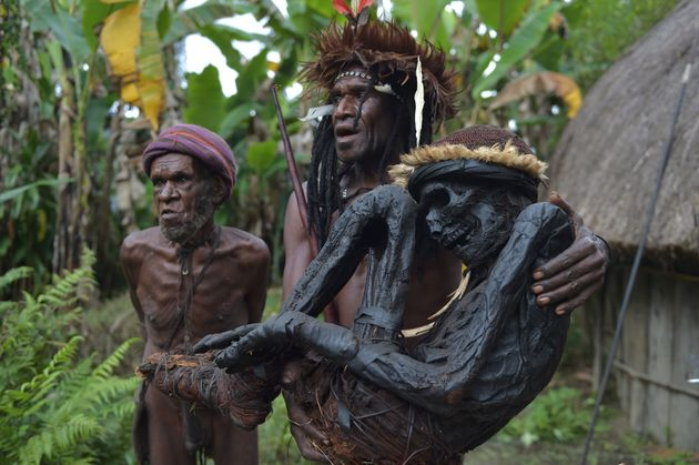 This photo taken on Aug. 7, 2016, shows Eli Mabel of the Dani tribe holding the mummified remains of...