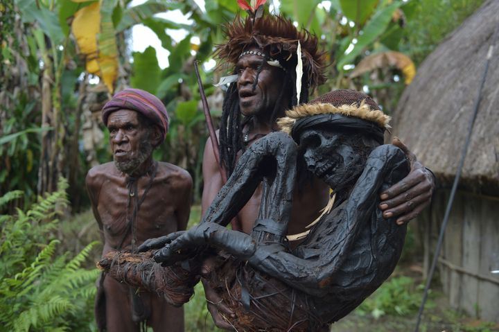 This photo taken on Aug. 7, 2016, shows Eli Mabel of the Dani tribe holding the mummified remains of his ancestor, Agat Mamet