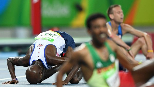 Mo Farah of Britain prays after the Men's 10,000m final race.