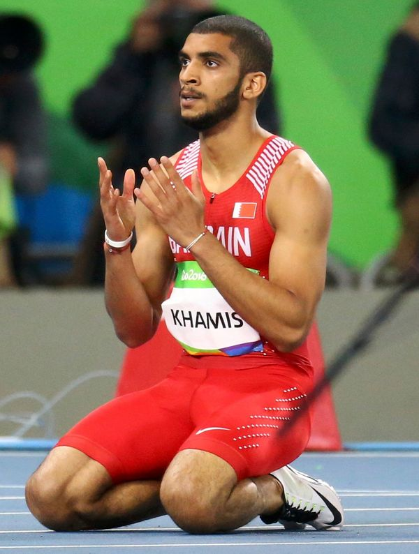 Ali Khamis Khamis of Bahrain prays after Men's 400m heats.