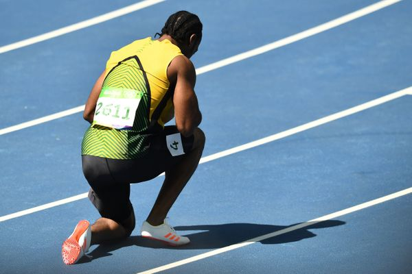 Jamaica's Yohan Blake prays after competing in the Men's 100m Round 1 at the Rio 2016 Olympic Games at the Olympic Stadium in