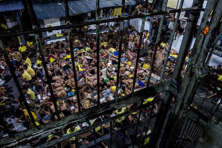 This picture taken on July 21, 2016, shows inmates sleeping at the open basketball court inside the Quezon City Jail in Manil