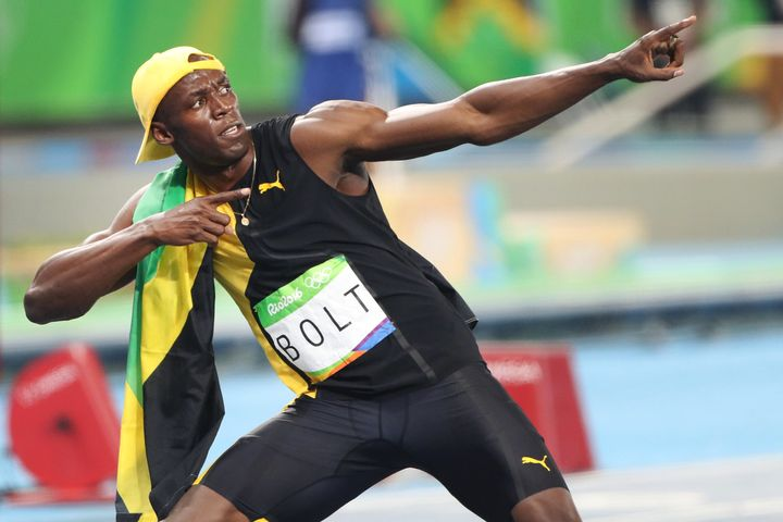 Usain Bolt of Jamaica strikes his 'Lightening Bolt' pose after winning the Men's 100m Final at the Olympic Stadium.